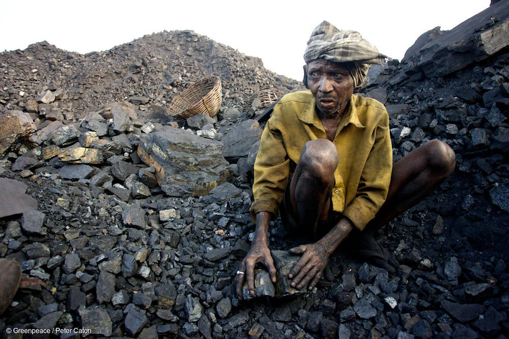 Coal mine worker in India