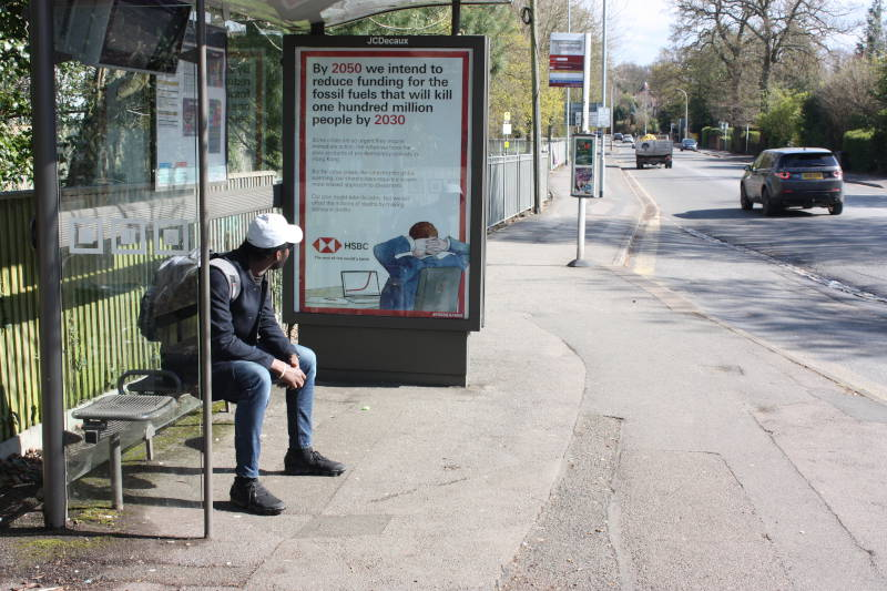 A spoof HSBC advert on a bus shelter